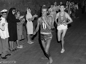 Bikila runs barefoot to victory in Rome.