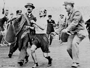 Pietri is helped toward the finishing line in 1908.