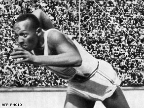 Owens defied Hitler by winning four gold medals in Berlin in 1936.