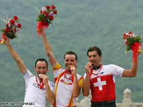 Davide Rebellin, Samuel Sanchez (center) and Fabian Cancellara celebrate their medals on the podium.