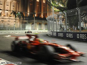 Massa hurtles round the Marina Bay circuit under the floodlights.
