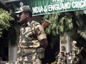 Indian security officers stand guard outside the hotel housing the England cricket team in Bhubaneswar.