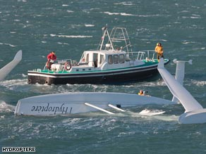 Capsized: French trimaran l'Hydroptere floats upside-down after flipping in high winds Sunday.