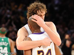 Gasol hugs Bryant as they celebrate an epic victory over the Celtics.