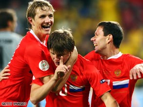 Andrei Arshavin, center, is mobbed by team-mates after securing Russia's place in the quarterfinals.