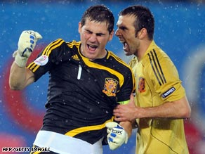 Spanish goalkeeper Iker Casillas and defender Carlos Marchena celebrate their side's victory over Russia.