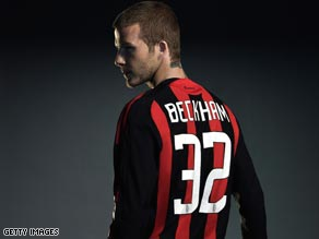 David Beckham parades his new AC Milan kit after completing his three-month loan to the Italian club.