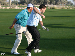CNN's Justin Armsden threatens to pass on the inside during a re-run of the famous Boo Weekley dash.