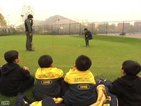 Second-graders at Beijing's Hujia School line up for their regular golf lesson.