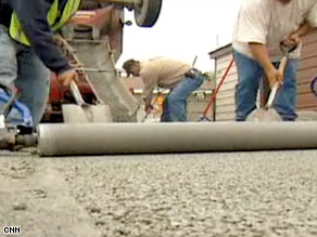 Chicago workers resurface alleys with permeable concrete that cleans rainwater before it runs into Lake Michigan.