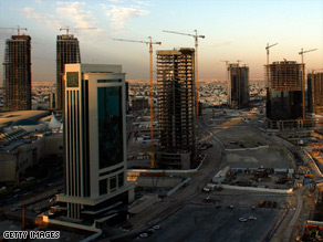 Doha, Qatar: A city skyline awash with cranes and towers powered by abundant oil and gas supplies.