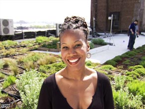 Majora Carter in front of a green roof in the Bronx