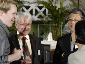 Hosts, Michael Holmes and Michael Elliott, question Milton Tan and Peter Head.