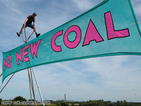 Climate campers erect their banners at Kingsnorth in Kent, United Kindom.
