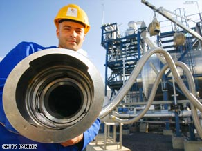 An engineer holds a pipe which will collect CO2 from the new CCS pilot project in Germany.