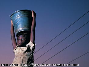 This 4-year-old girl in Ghana walks 2 1/2 miles twice each day to carry water for her family.
