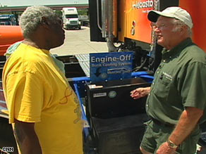 Buck Threehouse, right, explains the BlueCool system to a trucker at a Georgia truck stop.