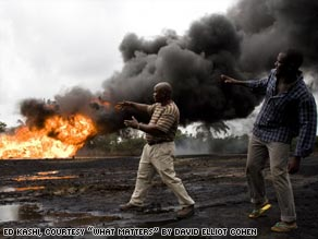 In the Ogoniland village of Kpean, an oil wellhead that was leaking for weeks turns into a raging inferno.