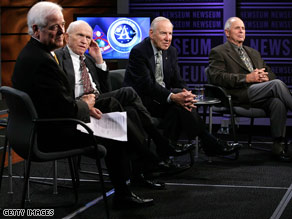 Host Nick Clooney (left) and astronauts Frank Borman, Jim Lovell and William Anders answer questions in October.