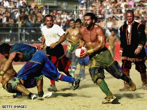 A Verdi player finds a gap in the Azzurri team's defence during the 2003 Calcio Storico