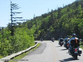 Bikers approach Mount Mitchell, North Carolina, during a road trip through the Blue Ridge Mountains.