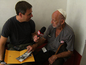 Steve Kastenbaum talks with Salomon Leyderman outside the Adath Israel synagogue in Havana, Cuba.