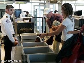 Passengers prepare for a security screening at Washington Dulles International Airport in Virginia.