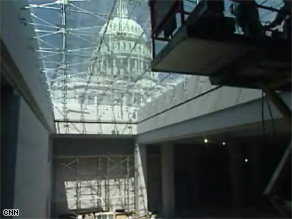 The underground visitor center, seen here under construction, has skylights allowing views of the Capitol.