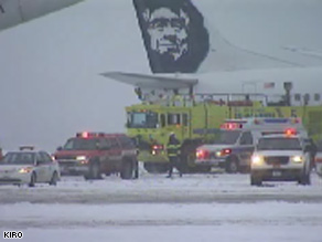 Emergency vehicles gather around Alaska Airlines planes in Seattle, Washington, on Wednesday.