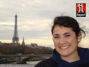 Lauren Hetrovicz, 21, stands across the river from the Eiffel Tower in Paris, France.