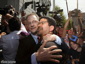 Gay couple John Lewis, left, and Stuart Gaffney celebrate outside the California Supreme Court on Thursday.
