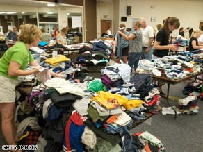 Red Cross volunteers sort donated clothing for flood victims at Prairie High School in Cedar Rapids, Iowa.