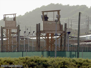 A guard looks over the U.S. military detention facility at Guantanamo Bay, Cuba, in this 2002 photo.