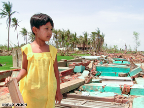 Nway walks among the ruins of her village school, which was destroyed by Cyclone Nargis.