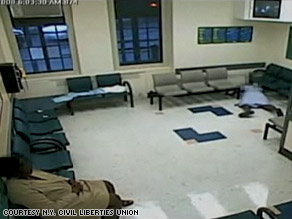Surveillance video shows a woman lying on the hospital floor for almost an hour before anyone helped her.