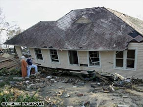Gloria and Howard Griffith stand on the porch of the Biloxi home they're trying to rebuild after Katrina's destruction.