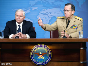 Adm. Mike Mullen, right, and Defense Secretary Robert Gates speak at the Pentagon on Wednesday.