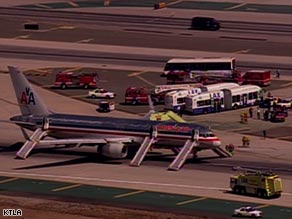 Inflatable chutes extend from a jet that made an emergency landing Tuesday in Los Angeles.