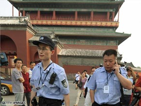 Chinese police are shown at the Drum Tower in Beijing last weekend.