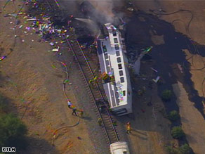 A commuter rail car lies on its side after a collision Friday near Los Angeles, California.