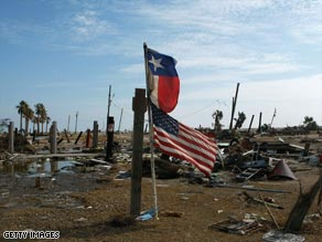 Flags of the United States and Texas fly where homes stood in Gilchrist, Texas, before Ike's wrath came ashore.