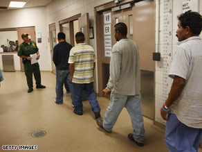 Illegal immigrants are processed in August at a U.S. Border Patrol station near Laredo, Texas.