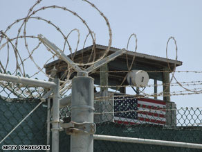 A guard tower is visible behind razor wire at the military facility at Guantanamo Bay, Cuba.