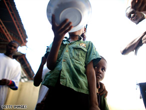 A food riot erupts in Haiti. Food scarcity is now hitting more affluent countries, experts say.