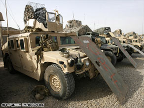 Marines' armored Humvees are parked at a miltary camp in Fallujah, Iraq, in May 2007.