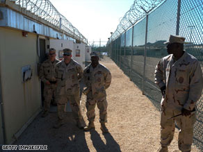 Three men have become the first detainees released from Guantanamo Bay after a court ruling.