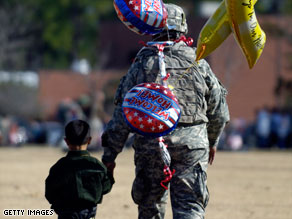 A soldier is welcomed home from Iraq by his son at Fort Stewart, Georgia, earlier this month.