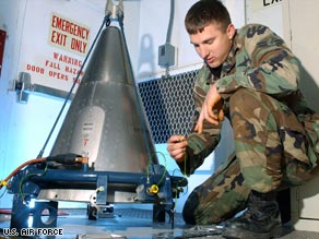 In an Air Force file photo, an airman inspects a missile part at a training site.