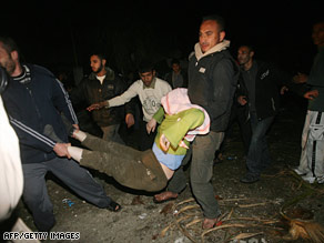 Men carry a wounded woman in Rafah in the southern Gaza on Wednesday.