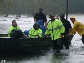 Rescue crews east of Baton Rouge had to navigate floodwaters and hundreds of fallen trees.